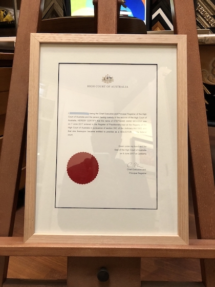 A High Court certificate framed in a Tasmanian oak frame with a black core mat board surround and UV glass.