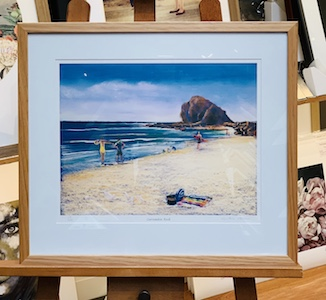 A small print that is of a beach that where my client spent a lot of time during her youth. We have used an Australian blackwood frame, mat surround and UV glass. We need sunscreen on the beach and UV glass on frames. Sun can cause irreparable damage to skin and art.